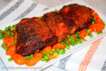 Crispy Chicken Thighs with Peas and Carrots - caribbeangreenliiving.com