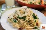 Spaghetti with sun-dried tomato and watercress