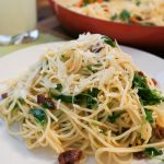 Spaghetti with sun-dried tomato and watercress