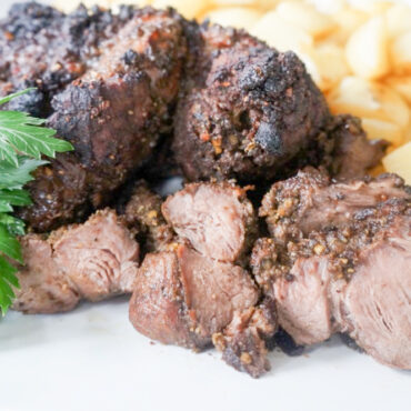 The Best Roasted Boneless Leg of Lamb served with Pan-Roasted Potatoes