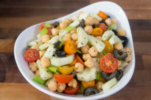 Cucumber, chickpeas, olive and tomato salad