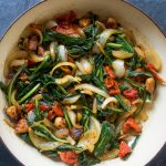Spicy Dandelion Greens with Sausage, Sun-dried Tomatoes, and Vidalia Onion