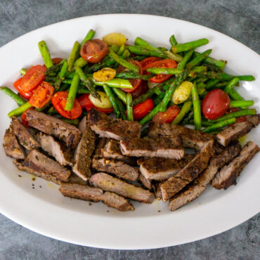 Sauteed Asparagus With Cherry Tomatoes and Steak Dinner