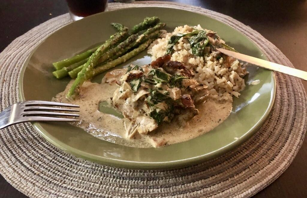 Creamy Garlic Dijon Chicken Thighs with Spinach and Bacon Bits