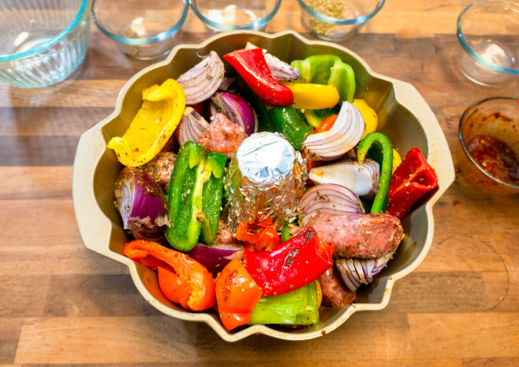 Vegetables and Sausages in Bundt Pan for Roasted Chicken.